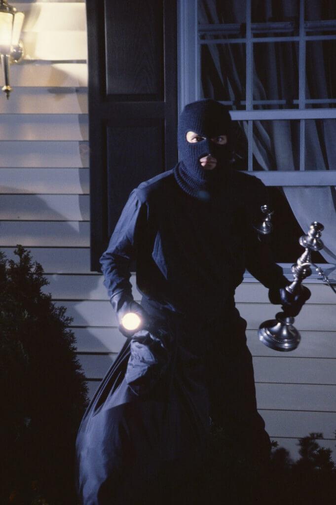 Burglar with bag of stolen items