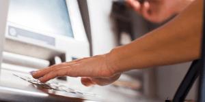 person using a ATM machine